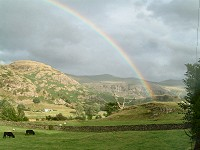 rainbow over hills and countryside